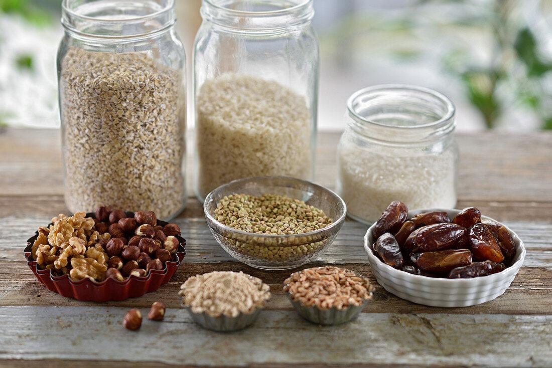 Vegan healthy baking ingredients in jars and bowls