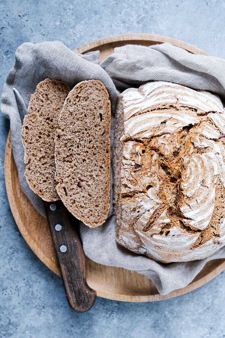 Sourdough bread sliced with a knife