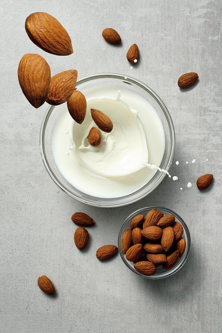 Almonds falling into almond milk