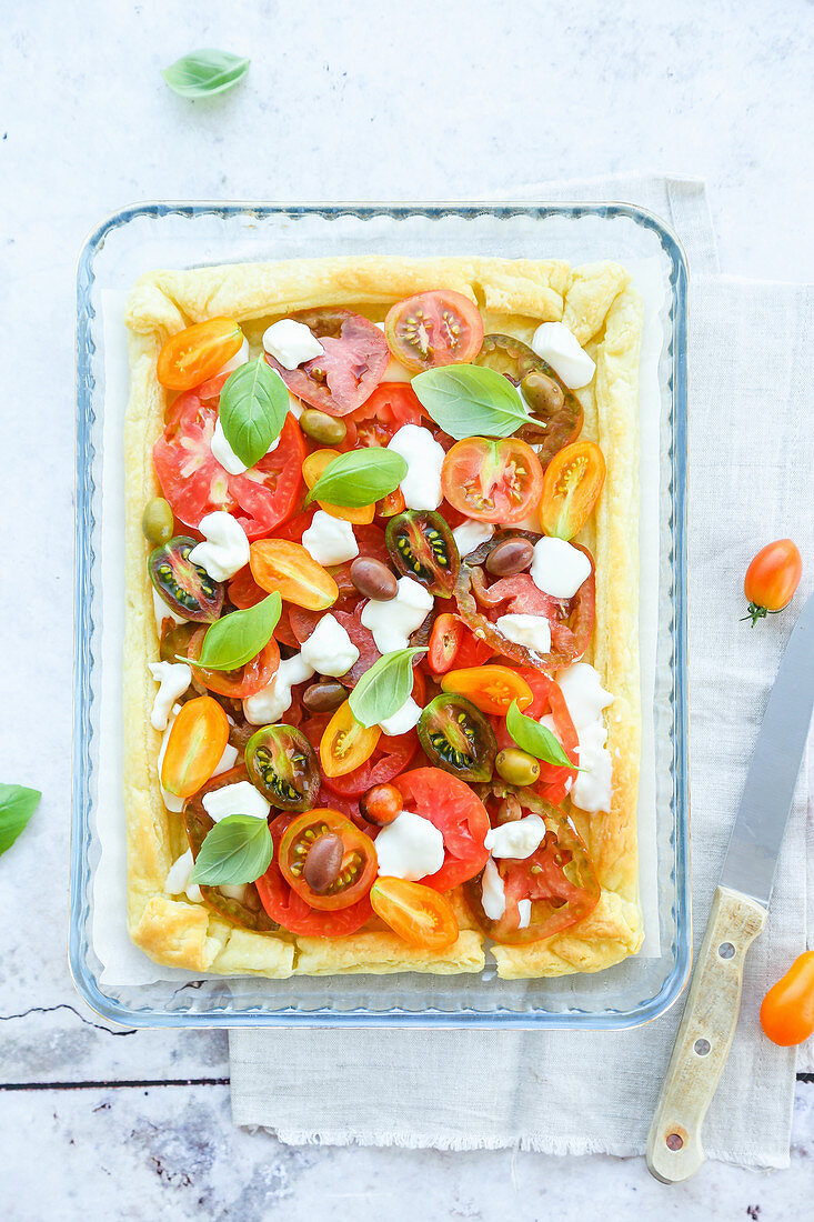 Puff pastry cooked in white and stuffed with fresh tomatoes stracchino olives and basil