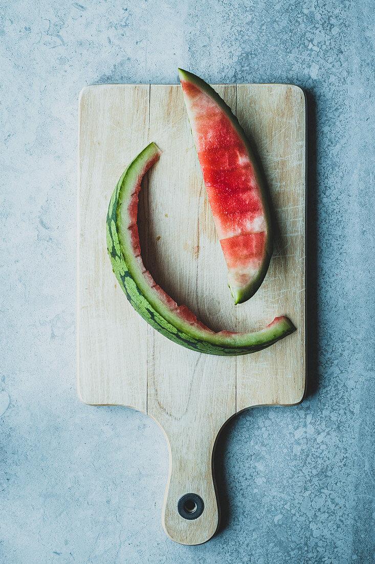 Watermelon skin on a cutting board