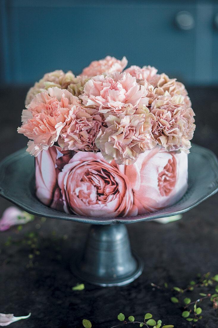 Black sesame cake with rose decoration
