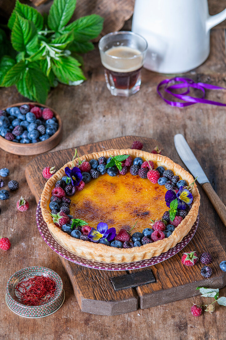 Berry brulee tart with saffron