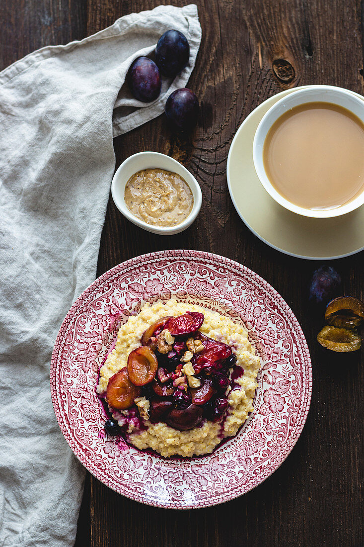 Millet porridge with almond butter and plums