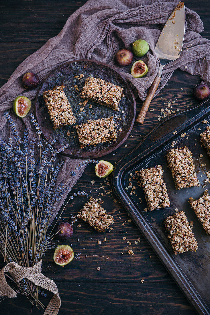 Figs oat bars on a rustic dark wooden table