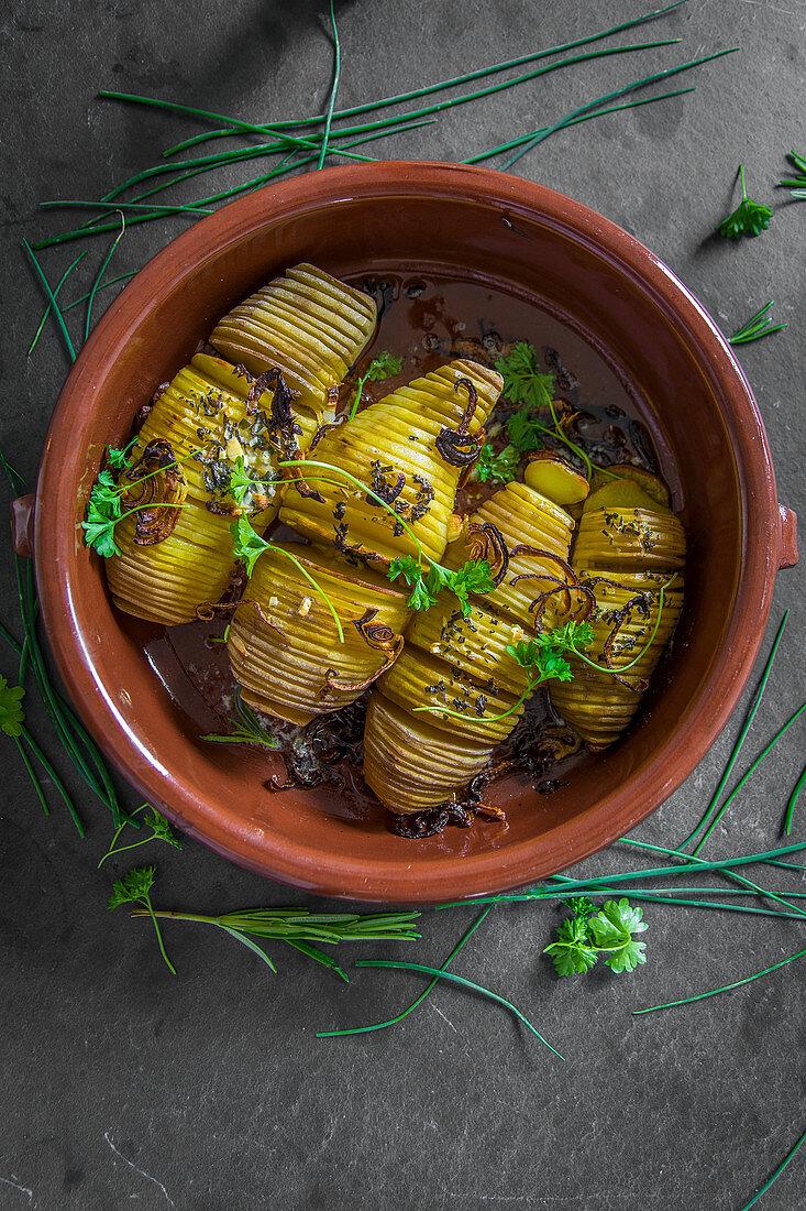 Fan potatoes in a clay bowl