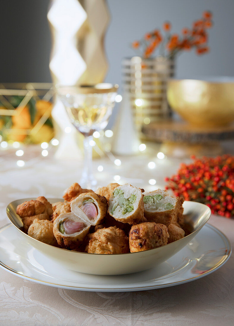 Pettole (deep-fried dough balls filled with vegetables, Italy)