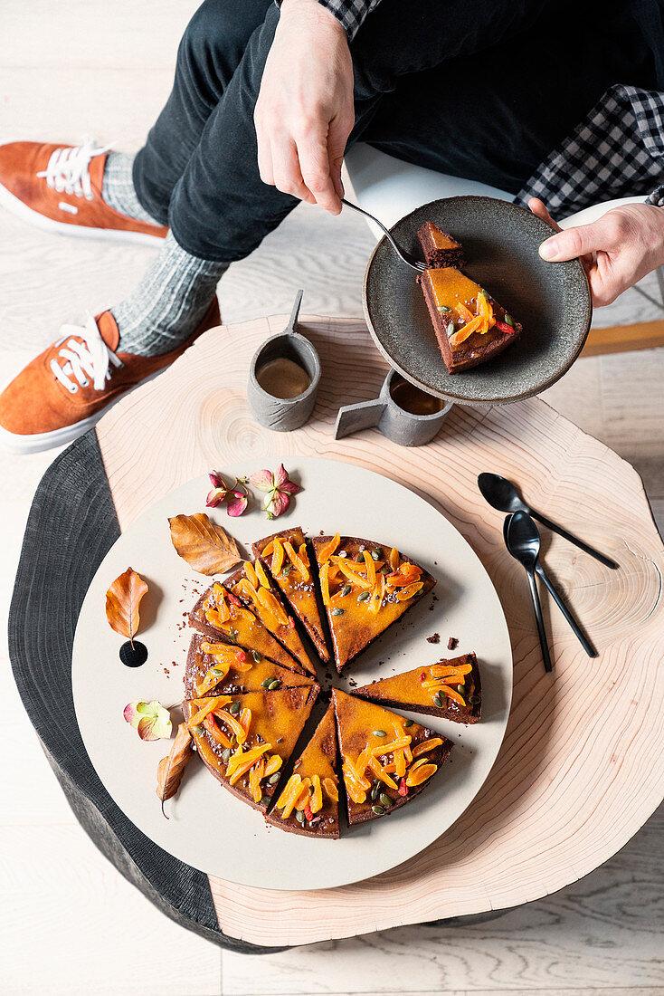 Chocolate cake with an apricot glaze and cardamom
