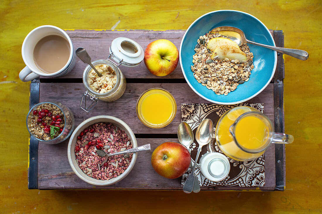 Three kinds of cereal with orange juice and coffee on a wooden box