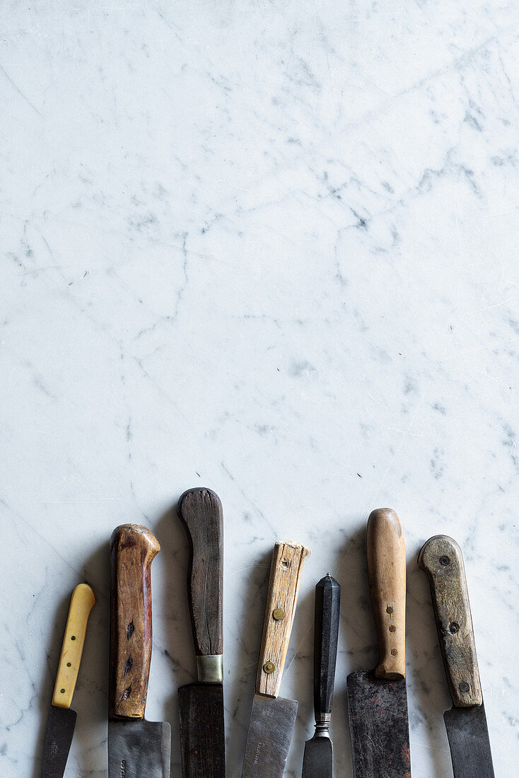 Meat knives on marble