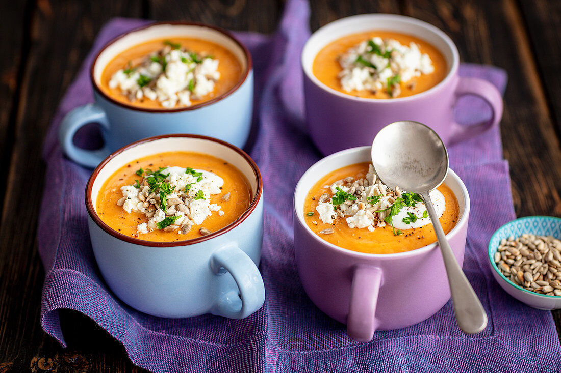 Lentils and tomato cream soup with feta