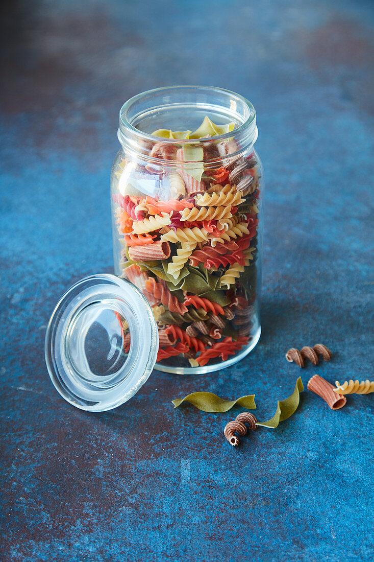 Coloured pasta in storage jar