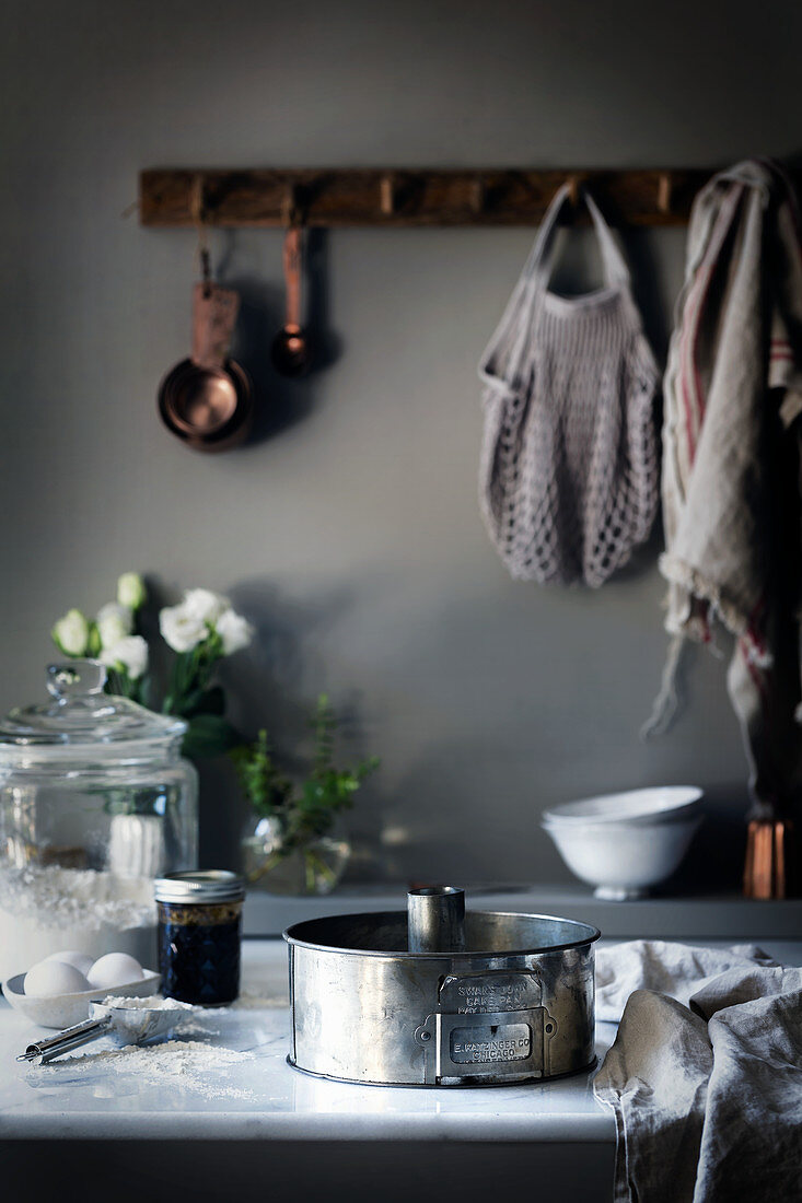 A baking dish and baking ingredients on a worktop in a rural kitchen