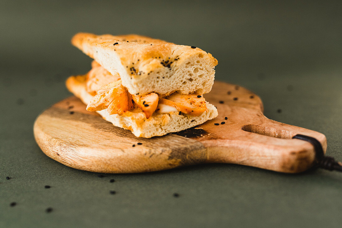 Delicious flat bread sandwich with chicken and black sesame