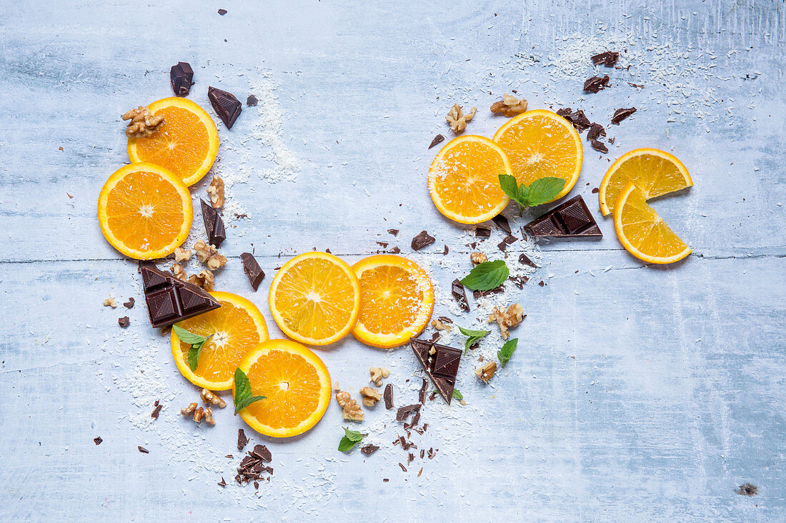 Orange slices, chocolate pieces and nuts