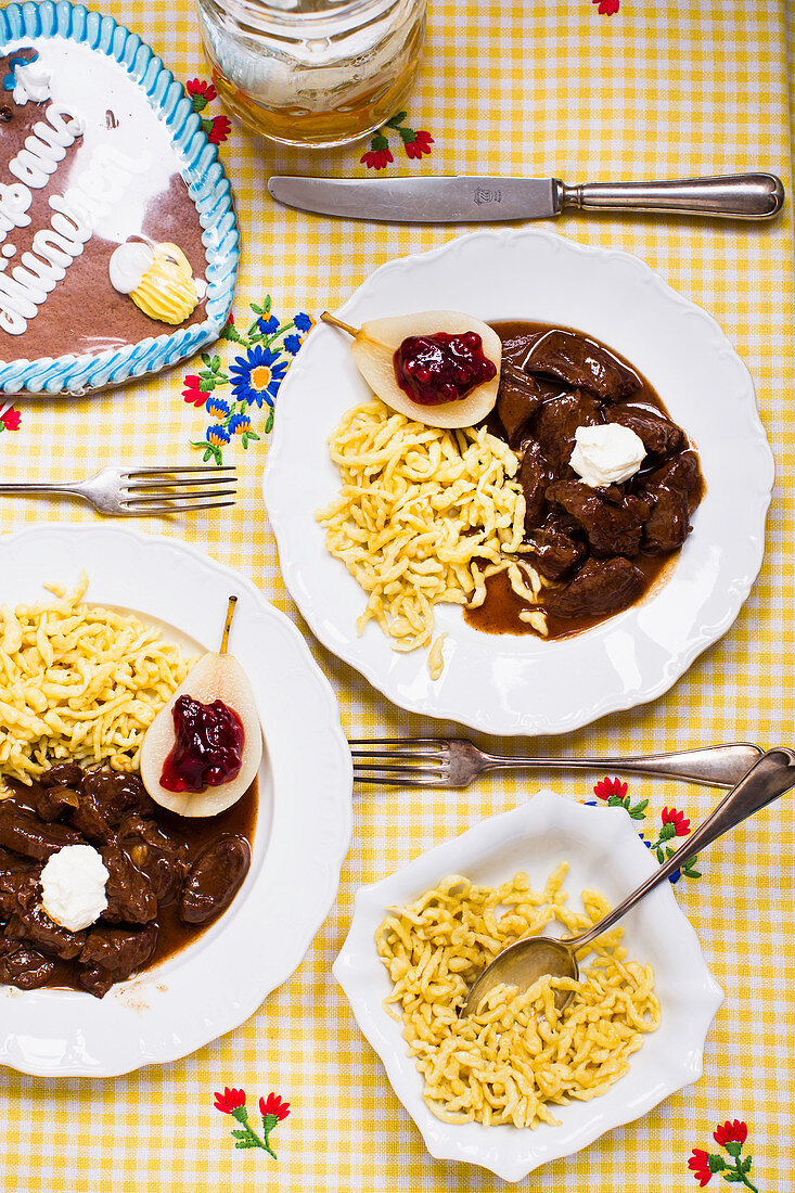 Venison ragout with Spätzle (soft egg noodles from Swabia) and a lingonberry pear