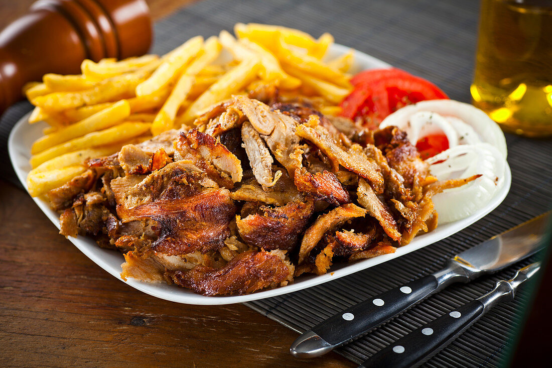 Greek pork gyros served with fried potatoes