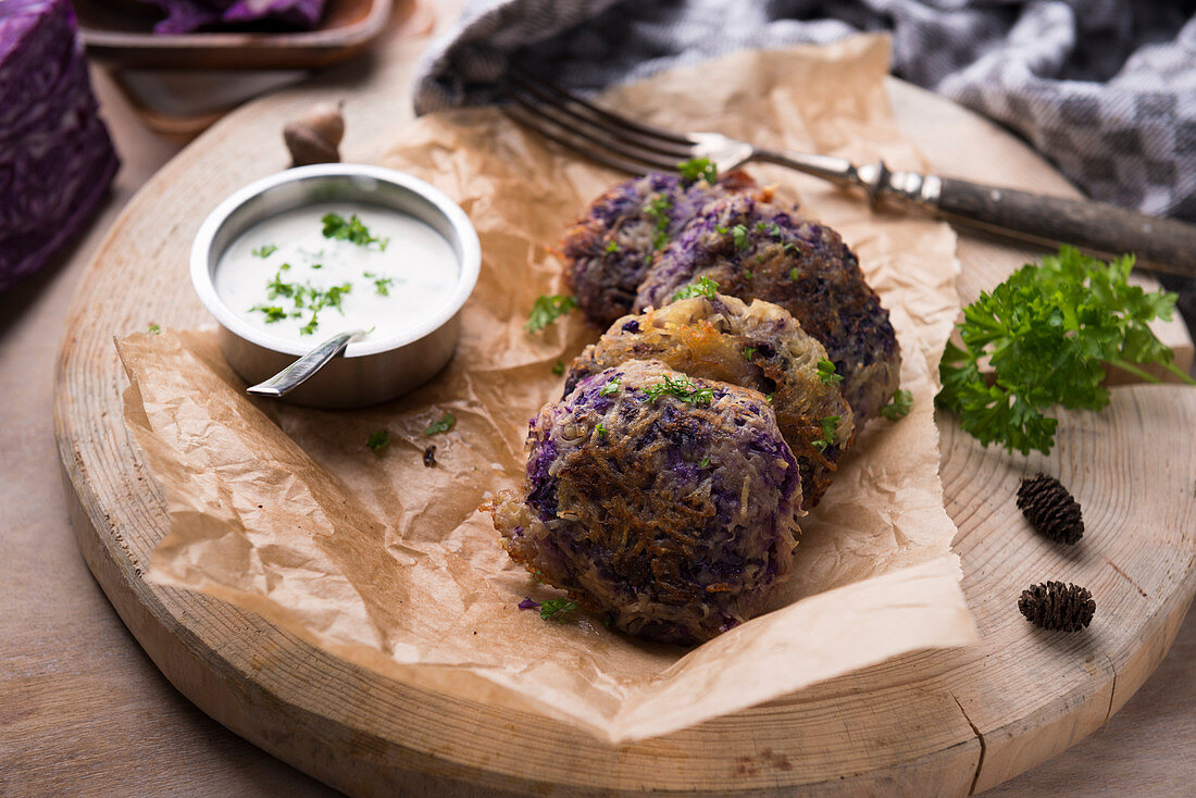 Vegan red cabbage and potato fritters with a herb dip