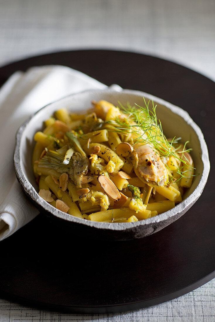 Ziti with saffron infused grasshopper, artichokes and almonds