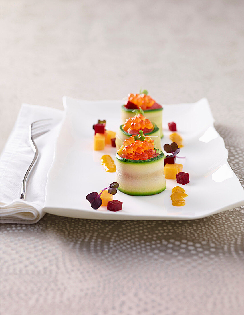 Courgette rolls with tuna, mango, beetroot tartare and salmon caviar
