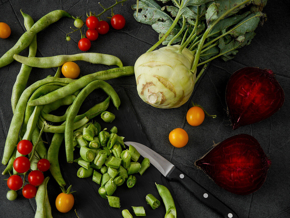 Vegetable still life with beans, tomatoes, kohlrabi and beetroot