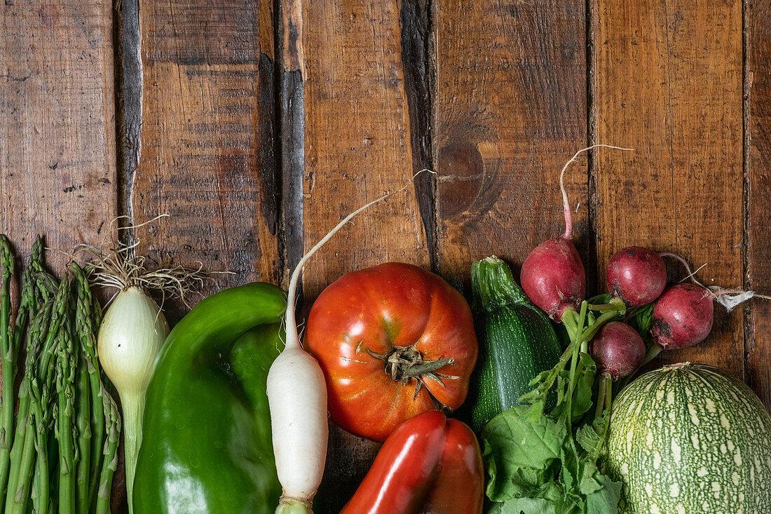 Fresh organic vegetables on a dark wooden table