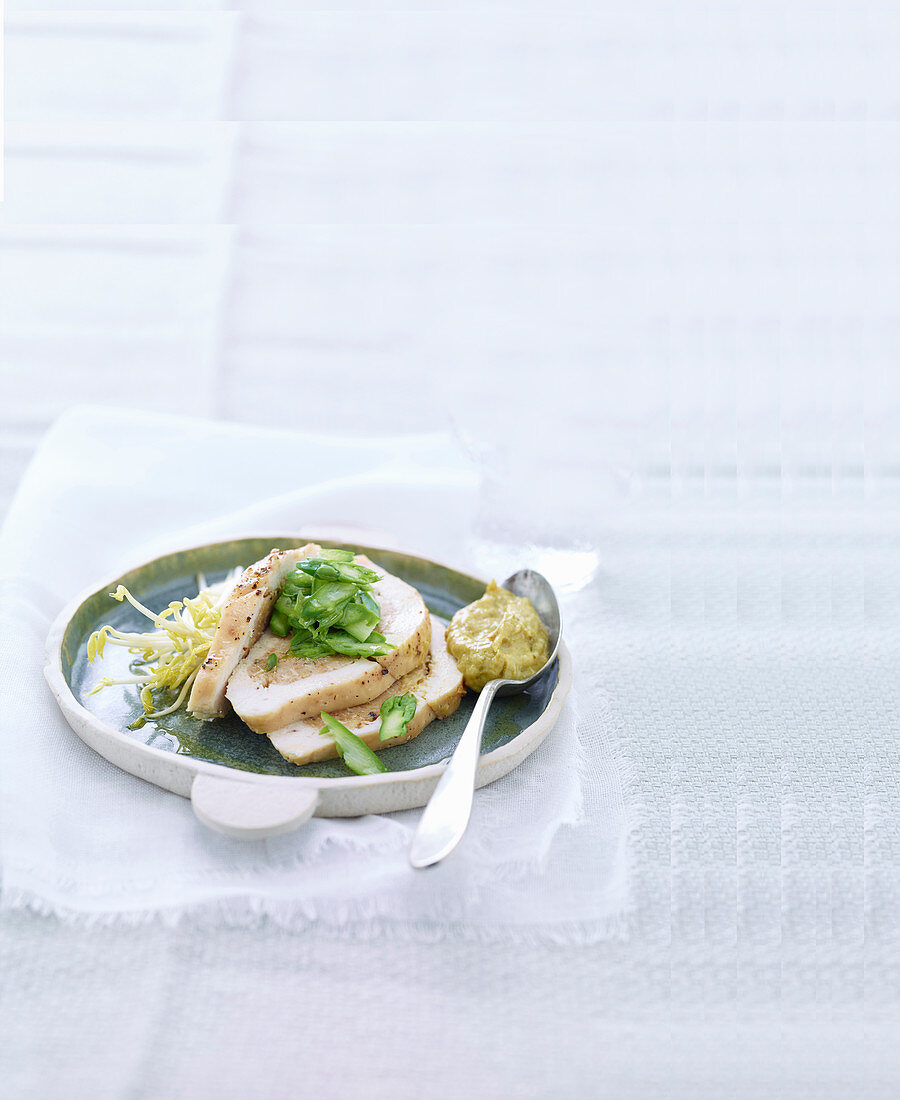 Chicken breast filled with bean sprouts and green asparagus