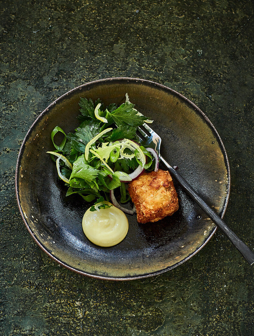 Breaded veal tongue with frisee lettuce and lemon mayonnaise