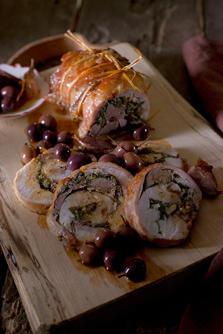 Rabbit roulade with olives, lardo and wild fennel