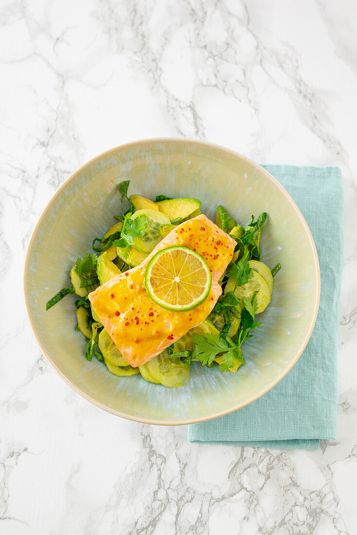 Avocado salad with spicy salmon fillet