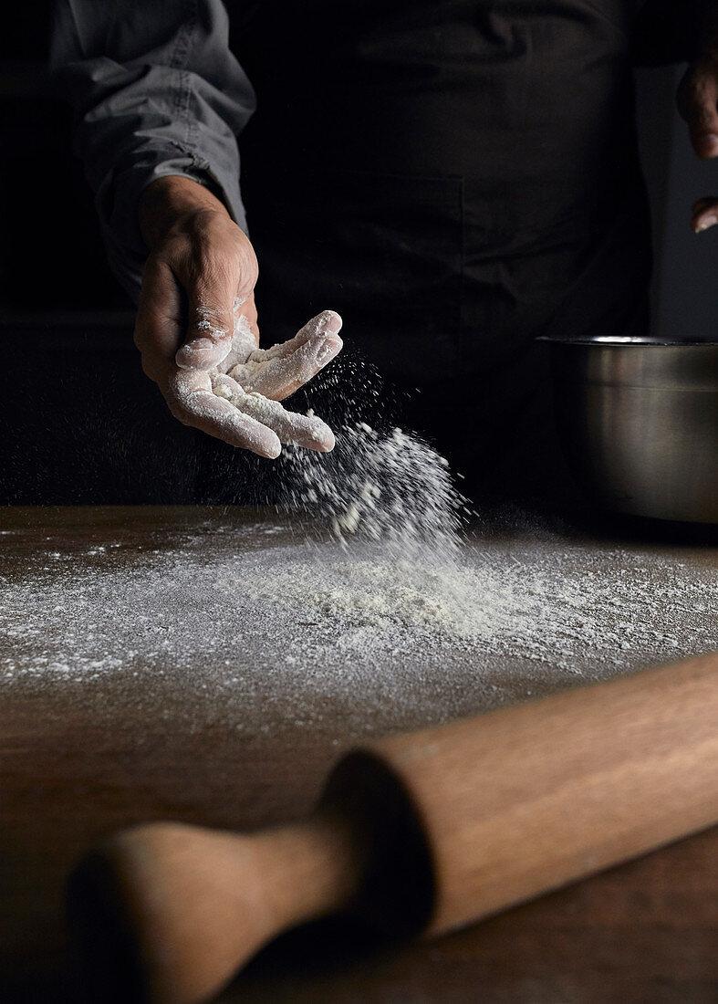 Sprinkling flour onto a table