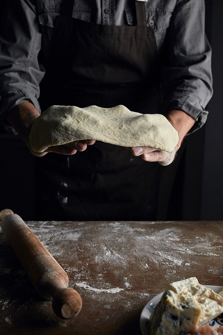 Tossing sourdough covered in flour