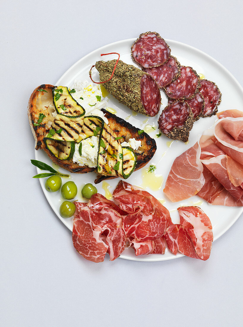 Antipasti plate with meath, prosciutto and salami