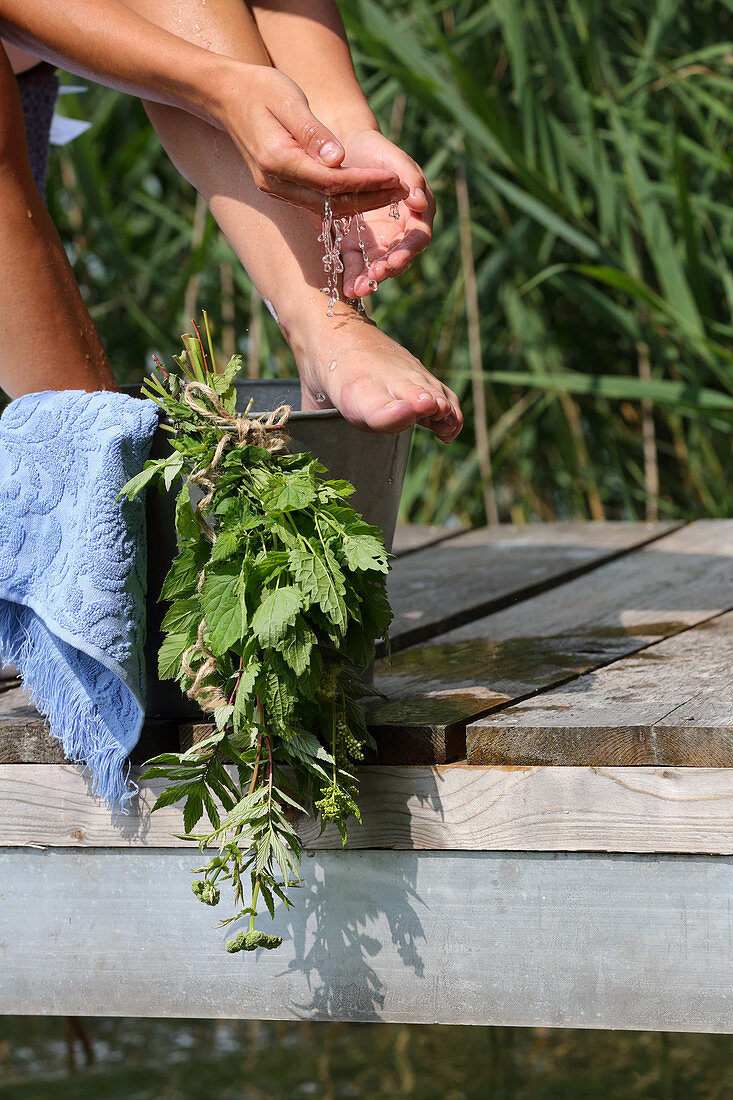A herbal foot bath made from stinging nettles, common horsetail and rosemary