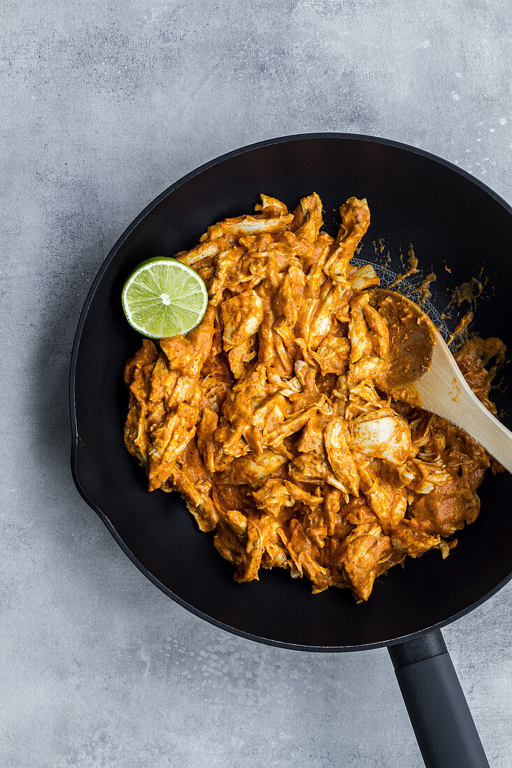 Traditional chicken curry with lime