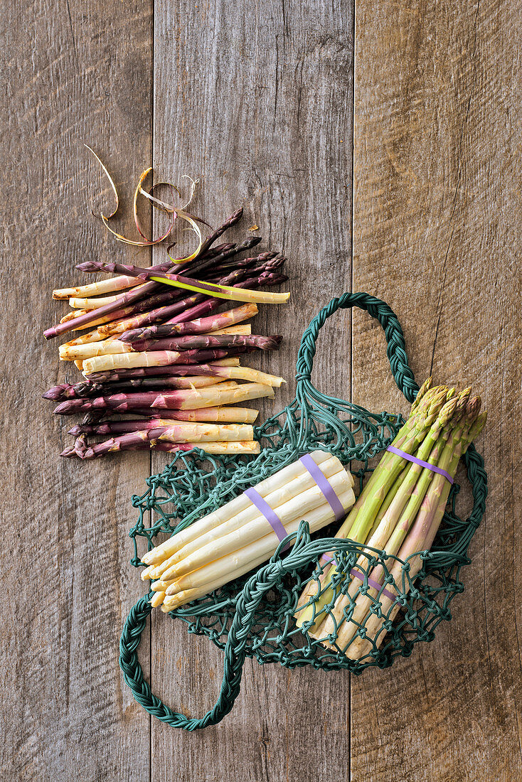 An arrangement of asparagus with shopping nets