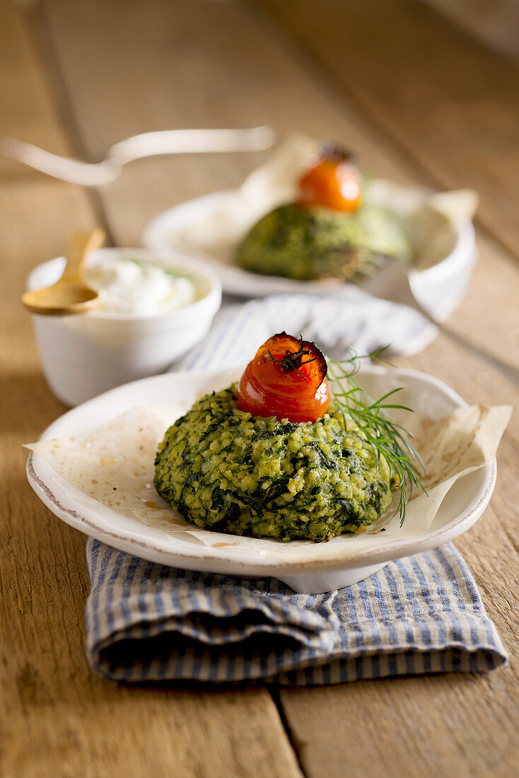 Oven-baked spinach and potato couscous with a yoghurt sauce