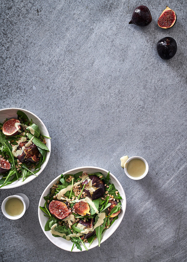 Honey-roasted figs on pearl barley with blue cheese sauce and fresh wild rocket