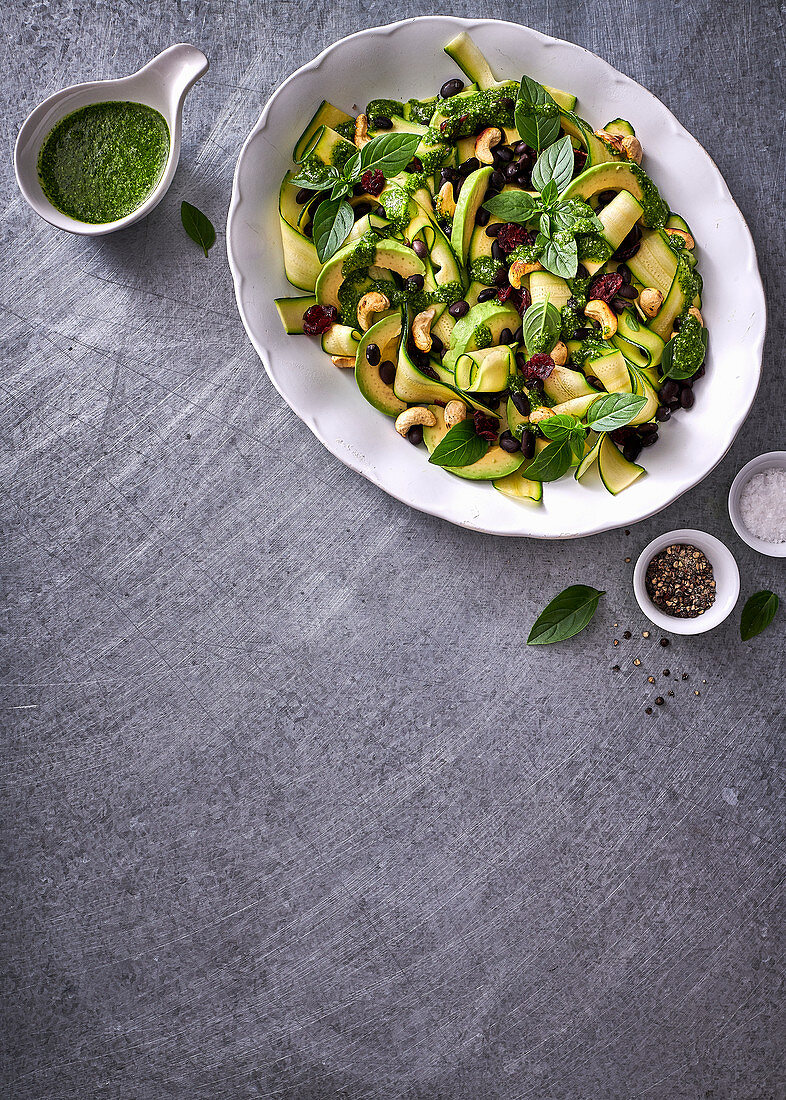 Black bean, avo and dried cranberry salad with coriander, parsley and parmesan dressing