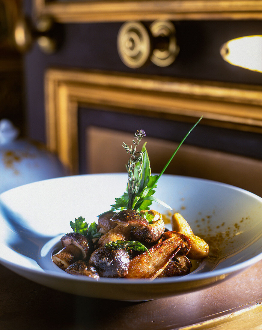 A mushroom dish made with button mushrooms, porcini mushrooms and herbs