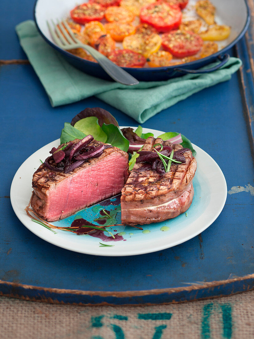 Beef medallion with red wine sauce and tomato and pistachio gratin