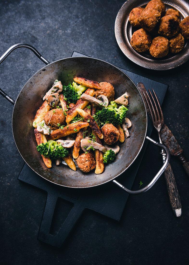 Vegan dumpling dish with bean balls, broccoli, mushrooms and cress