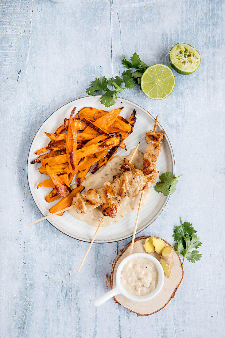 Chicken kebabs with peanut sauce and sweet potato wedges