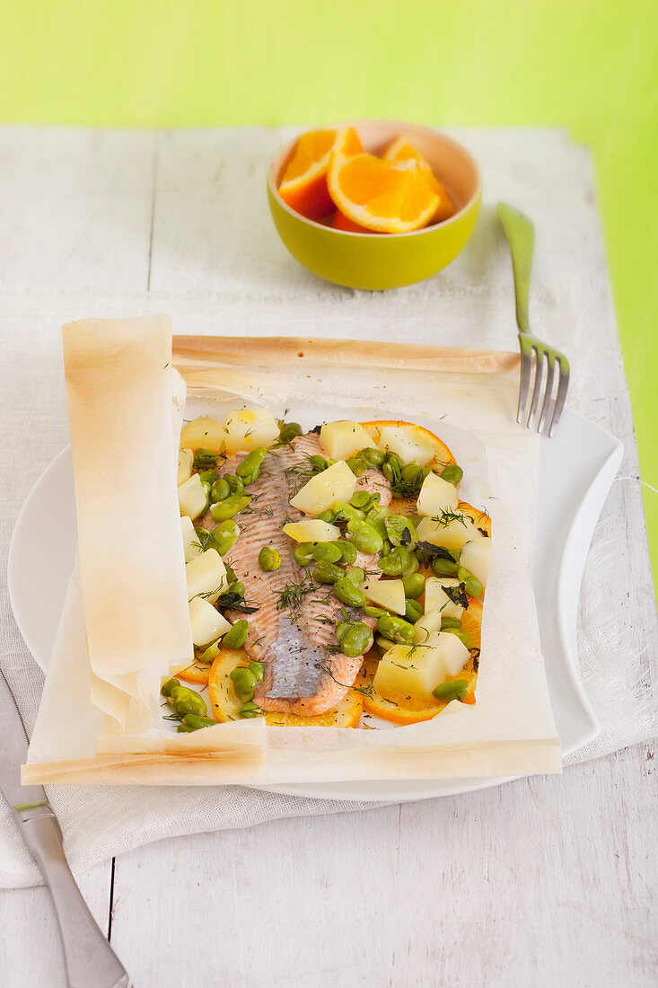 Orange trout with fava beans and potatoes