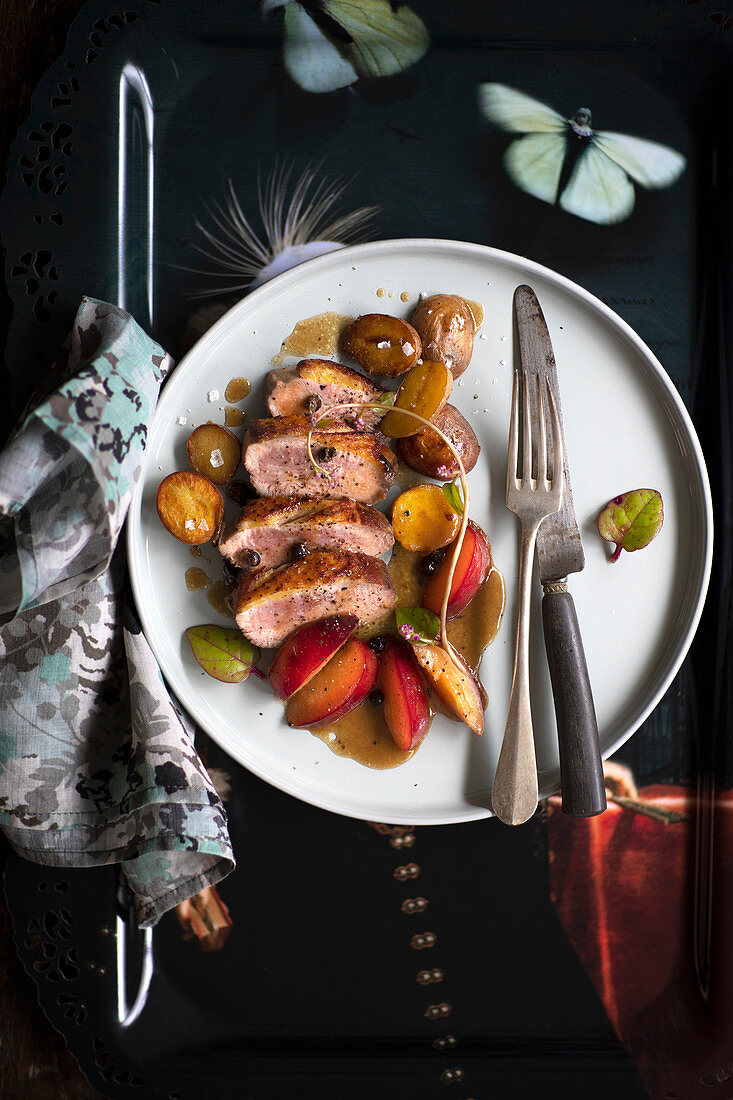 Gin and juniper duck breast with potatoes and plums