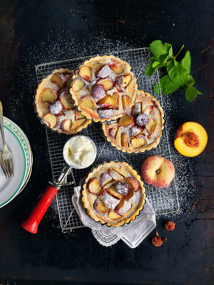 Small peach pies with vanilla ice cream