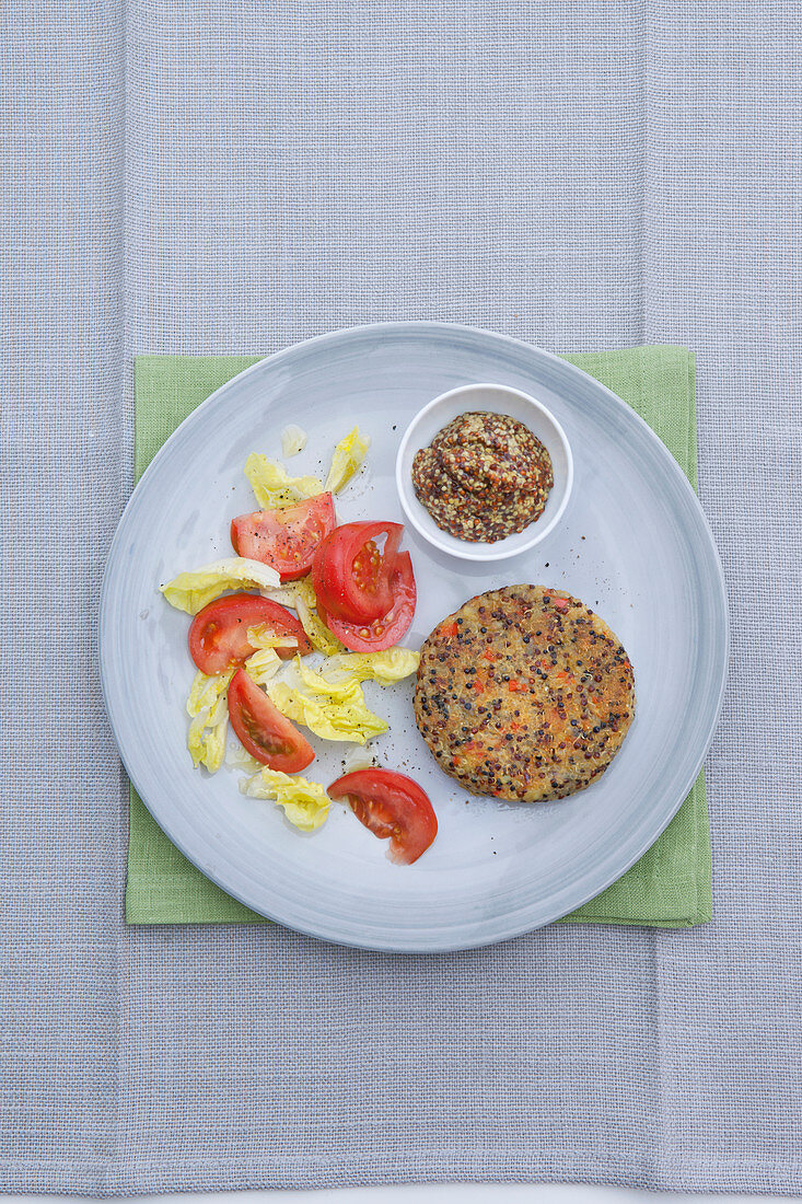 Quinoa and potato burger with salad