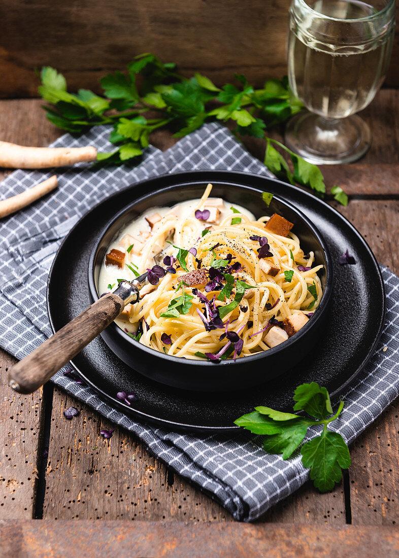 Spaghetti with parsnip cream, smoked tofu, parsley and cress (vegan)