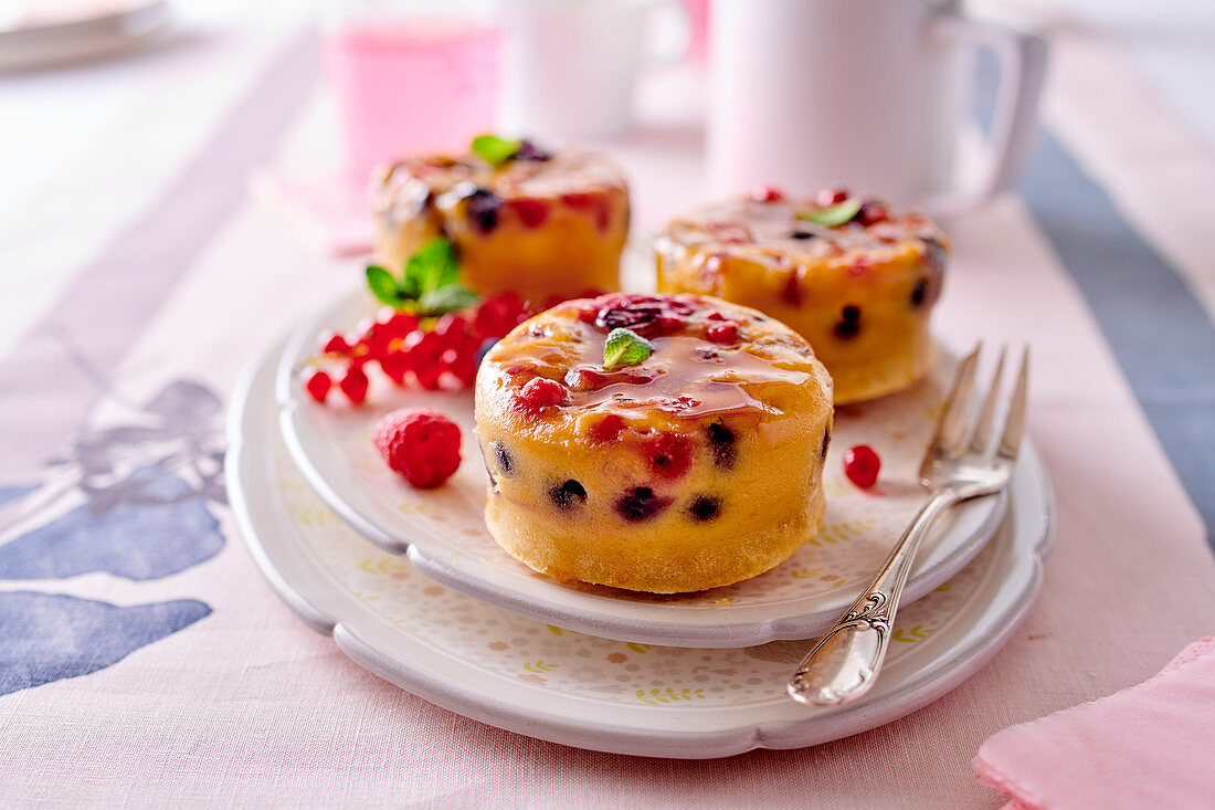 Red berry upside down cakes