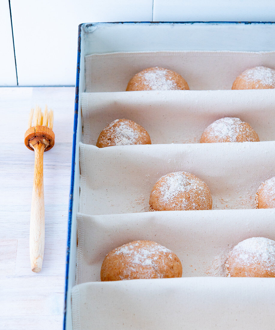 Freshly baked bread rolls on baker's linen